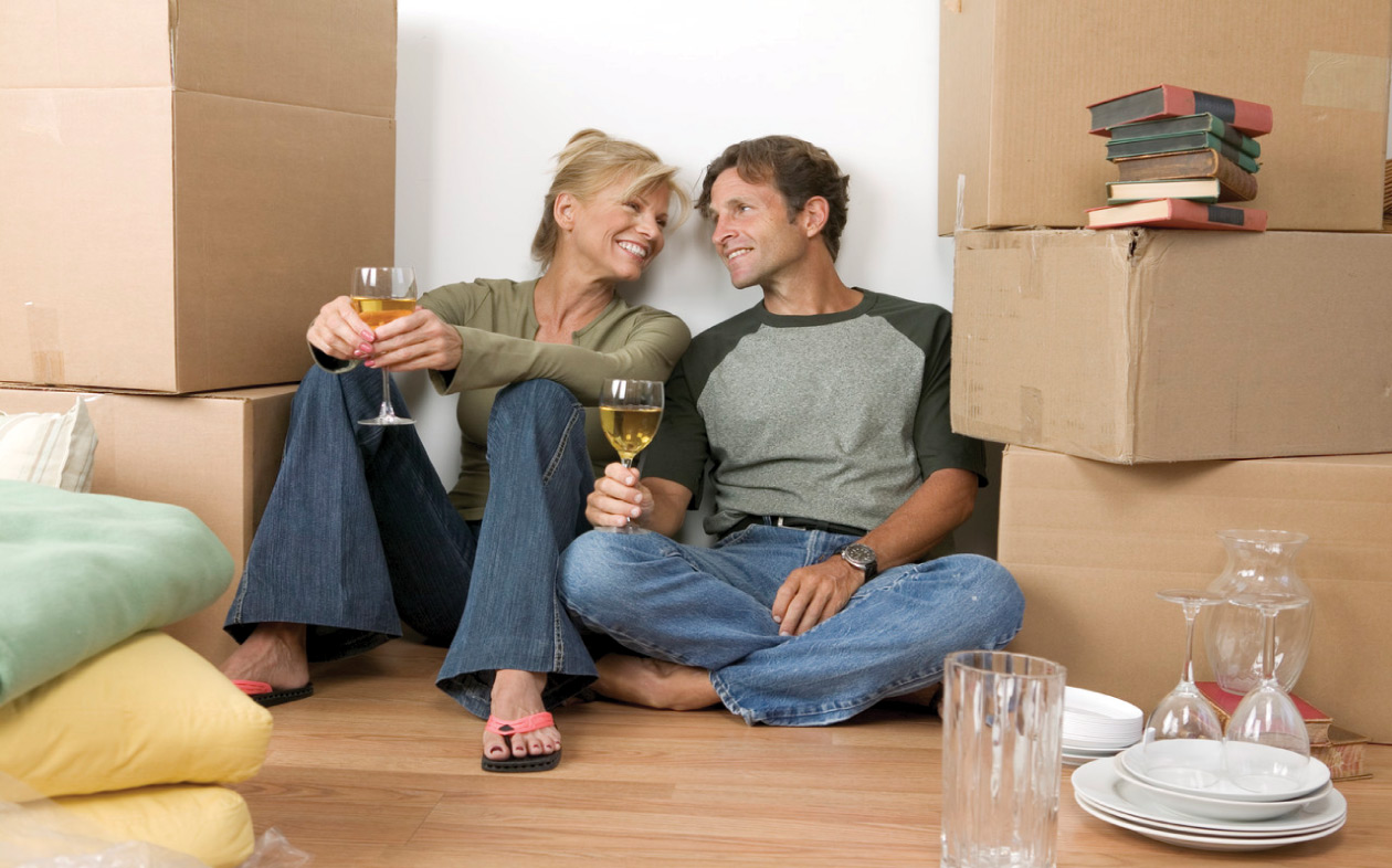 A couple relaxing and enjoying wine after packing services were provided by Charm City Movers in Windsor Mill, MD